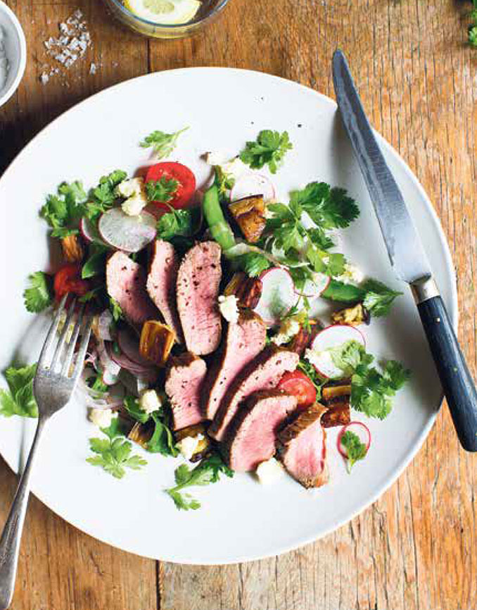 Shortloin of lamb with roasted eggplant and green bean, radish and cherry tomato salad